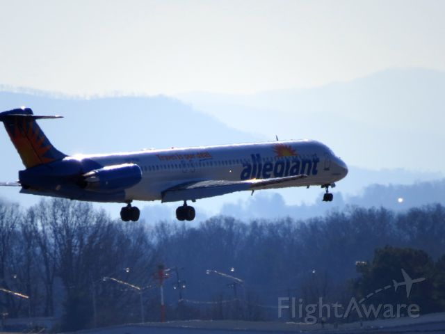 Airbus A320 (N874GA) - Landing with the hazy Great Smoky Mountains in the background.
