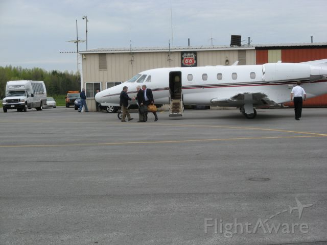 Cessna Citation Excel/XLS (N636EJ) - 2002 CESSNA CITATION EXCEL unloading passengers at Oswego County NY Airport (KFZY) on 5/5/09.