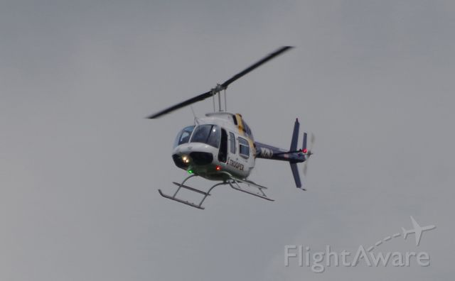 Bell JetRanger (N2NJ) - MORRISTOWN, NEW JERSEY, USA-JULY 24, 2020: A New Jersey State Police Helicopter, registration number N2NJ, is seen shortly before landing at Morristown Municipal Airport. The NJSP will help provide security for the arrival, in several hours, of President Trump on board Air Force One.