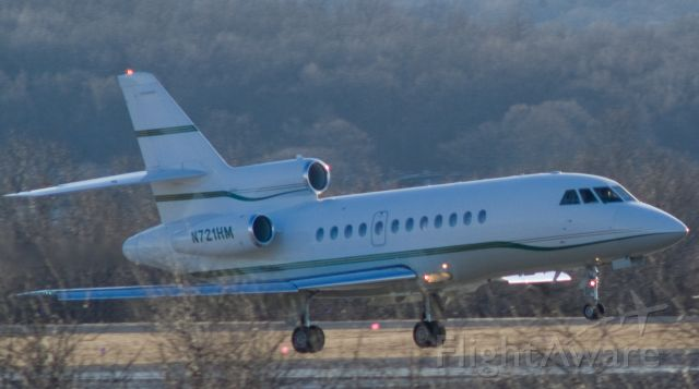 Dassault Falcon 900 (N721HM) - Another Falcon thru the trees at Oxford