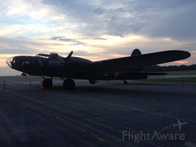 — — - Memphis Belle at KJVY. The movie aircraft.