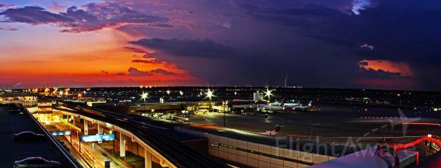 — — - KIAH sunset lightning storm.