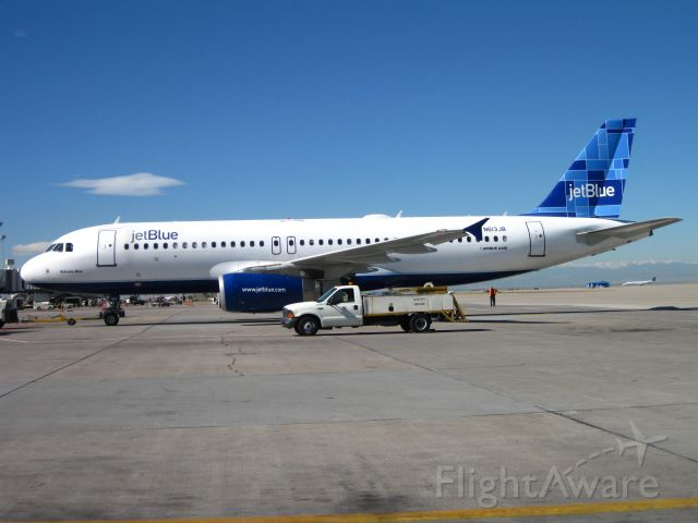 Airbus A320 (N613JB) - Being pushed back from A concourse at DIA.