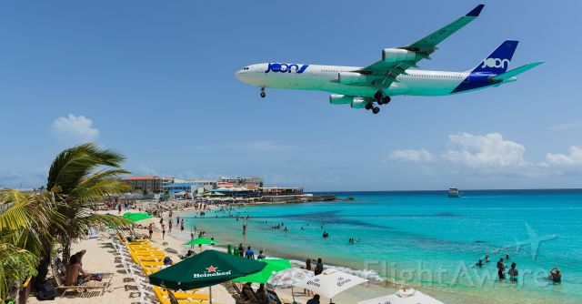 Airbus A340-300 (F-GLZP) - Low cost carrier Joon flying for Air France as Afr498 with the airbus A343 registration F-GLZP seen over maho beach for landing at TNCM St Maarten.<br />11/08/2018