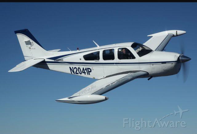 Beechcraft Bonanza (33) (N2041P) - Formation flying.