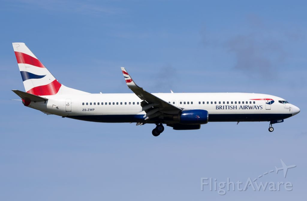 Boeing 737-800 (ZS-ZWP) - Directly behind the Safair B734 was this British Airways Comair B737-86N Next Gen ZS-ZWP, operating flight CAW6241 from JNB (FAOR) to PLZ (FAPE) on short finals to runway 26. This pic was snapped at 12:50pm on Wednesday 5 September, half an hour before the weather turned for the worse and I had to high-tail it out of there.