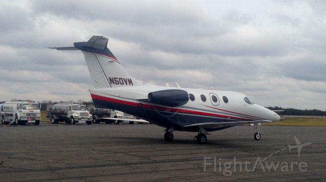 "Beechcraft Premier 1 — - Executive Jet Management ""Jet Speed"" flight #525 heading to runway 33 for departure at KINT."