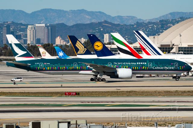 BOEING 777-300ER (B-KPB) - The City of Hong Kong taxing past the TBIT