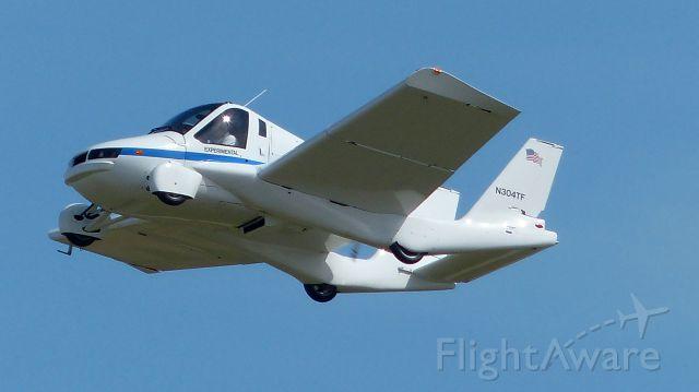 — — - Terrafugia in flight