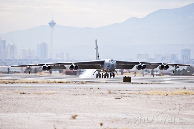 — — - B-52H returning from a Red Flag mission.