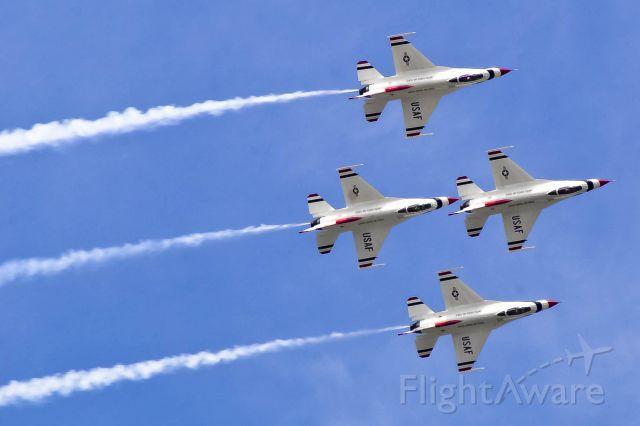 — — - The U.S. Thunderbirds do a diamond roll at Robins AFB.