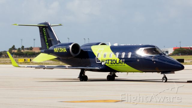 Learjet 60 (N613HA) - Parked at FBO Ramp.