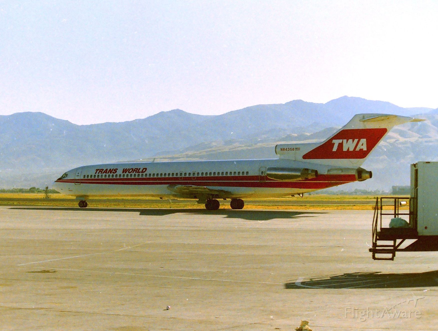 BOEING 727-200 (N84356) - KSLC - early up on a driving trip to Denver - 1988 or 89..a quick trip through the SLC terminal caught this TWA 727 headed for the main north-south departure runway for a probable trip to KSTL/STL St Louis MO. There was a Pan Am 727 and a Hawaiian Air DC-8 here getting ready to roll also..........if only I had more time!