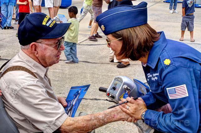 — — - Maj. Nicole Malachowski, right wing pilot for the the U.S. Thunderbirds, greets and talks with a WWII veteran at a Moody AFB Open House airshow.