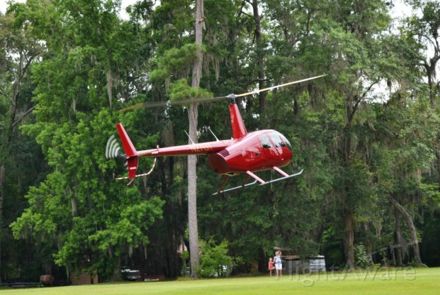 Robinson R-44 (N27GT) - Visiting family at the Raines Plantation, Welborn Florida.  (photo by Beth Lawton)