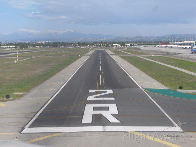 "— — - ""Hitting the numbers"".   Runway 2R at John Wayne International, Santa Anna, California.   Photo taken from right seat of SR22."