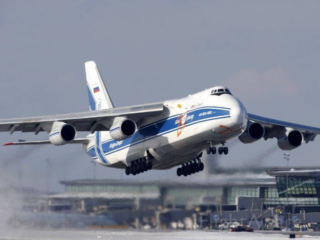 Antonov An-124 Ruslan (RNA82045) - The Russian Blizzard Maker climbing off Runway 14 on Feb 11, 2011 as flight VDA2118 to KNUQ