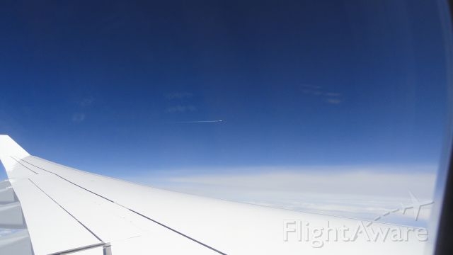— — - Munich to Mumbai on A340 with A320 vapour trail