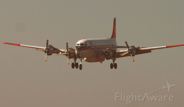 Douglas DC-7 (N838D) - KRDD - Tanker 60 (N838D) of Erickson Aero Transport returning from Weed, CA during the horrible Sept 2014 wildfire. This plane was loaded up in 10 minutes and off it went again - all of the Pilots did a magnificent job we heard later of stopping the spread of fire with precision Phos-chek drops at treetop level, covering homes and everything in sight as this had the potential of becoming a major conflagration in Sept 2014. Many homes were lost due to an idiot, and I mean an IDIOT, starting a grass fire on purpose, to get even with an apartment complex that evicted him. The stupid part was the wind was blowing in the opposite direction of what he wanted to do, and the fire burned the opposite way. I mean we