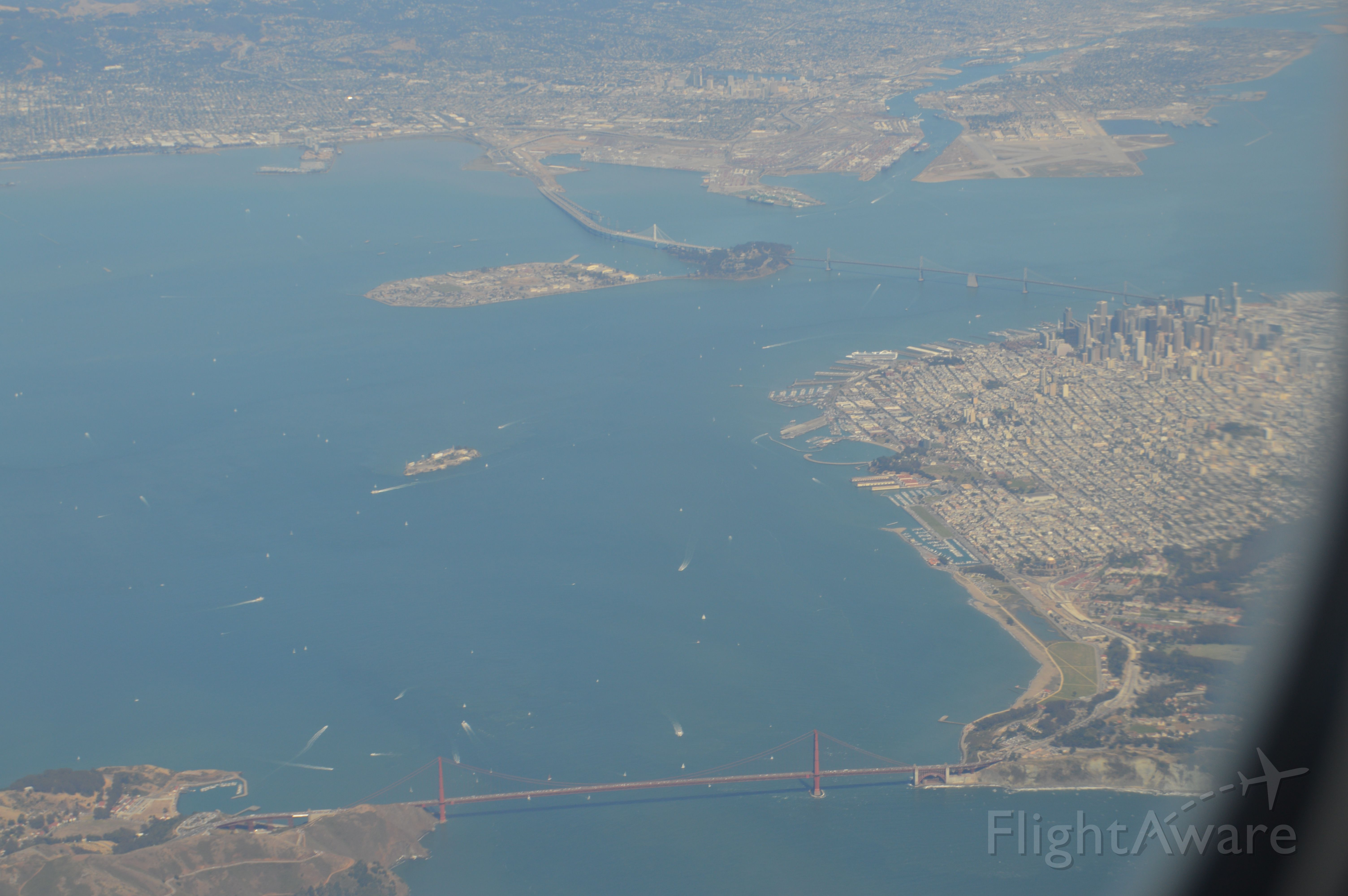 — — - View of downtown San Francisco and Golden Gate Bridge. Landing into SFO, United 59 from Frankfurt.