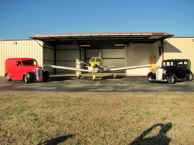 Piper Cherokee (N7723N) - Two Chevy's and a Piper PA-28 on the ramp.