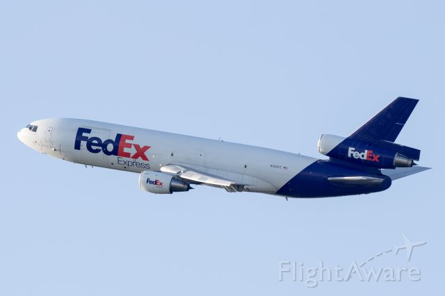 McDonnell Douglas DC-10 (N383FE) - Just after sunrise, departing 10L at Chicago OHare from the top of the MB Park.