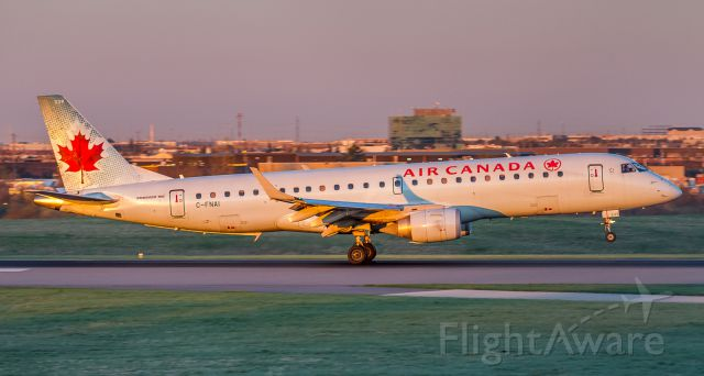 Embraer ERJ-190 (C-FNAI) - Sun just peeking over the Eastern horizon lighting up this Air Canada Embraer on runway 33L