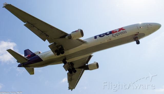 Boeing MD-11 (N528FE) - N528FE crosses the threshold at 50 feet on approach to 18R, almost blowing me over.