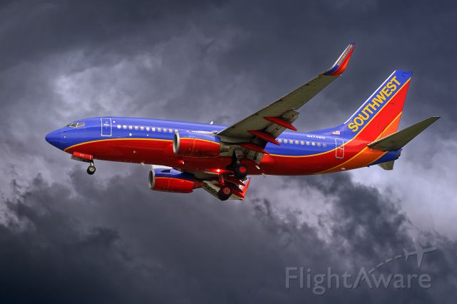 Boeing 737-700 (N474WN) - 7/3/2015. Right on the edge. Big storm NE of KTPA. Field reconfigured to N landings, This is a short approach to 1L.