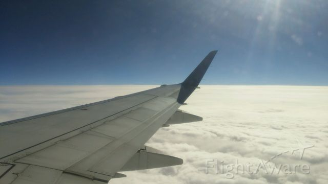 Embraer 170/175 (N215JQ) - TCF7320 (KIND-KBOS on 11/22).  Taken at 35,000ft over Upstate New York.  Shot from seat 13D.  Camera was an LG G3 SmartPhone