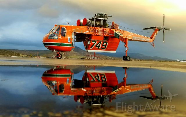 Sikorsky CH-54 Tarhe (N171AC) - With Rotor blades removed for MX, a puddle of water made this a perfect op.