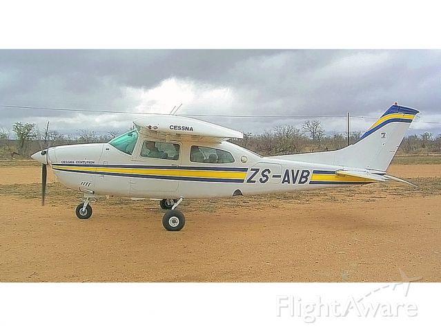 Cessna Centurion (ZS-AVB) - Guenter Schmitz prepares for another low level flight around Ingwelala, South Africa.