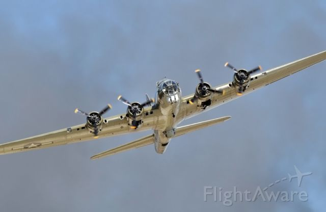 Boeing B-17 Flying Fortress (N900RW) - Exit from the photo pass during the 2008 Wings over Houston Airshow. Pyro smoke in the background. Thanks goes to Chris Ebdon (FlightAware member Ebdon) for the hookup.