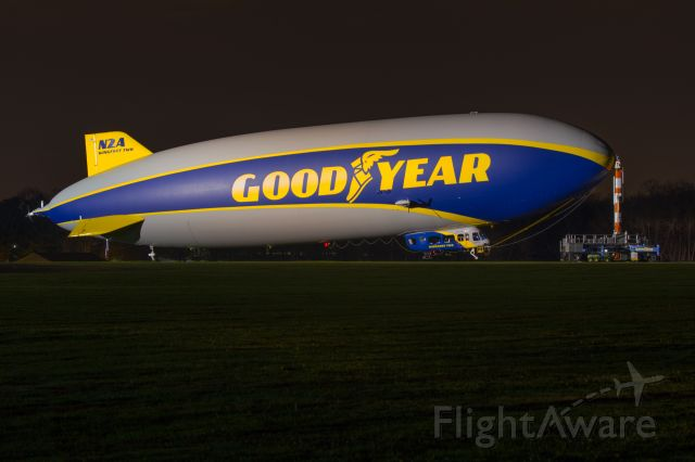 """Unknown/Generic Airship (N2A) - N2A """"Wingfoot Two"""" moored for the night, illuminated by the hangar lights at 4OH6."""