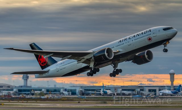 BOEING 777-200LR (C-FNNH) - Air Canada 772 climbs off runway 23 at sunrise