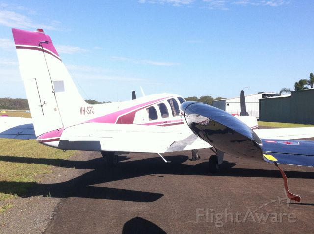 Beechcraft Baron (58) (VH-SFC) - It flew in from Cowra a few days ago, what do you think of the pink?
