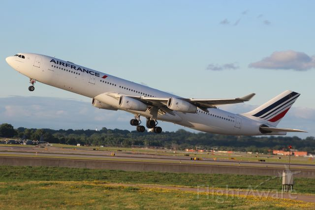 Airbus A340-300 (F-GLZS) - Evening 7:45 Airbus A-340 Air France departure for Charles de Gaulle.