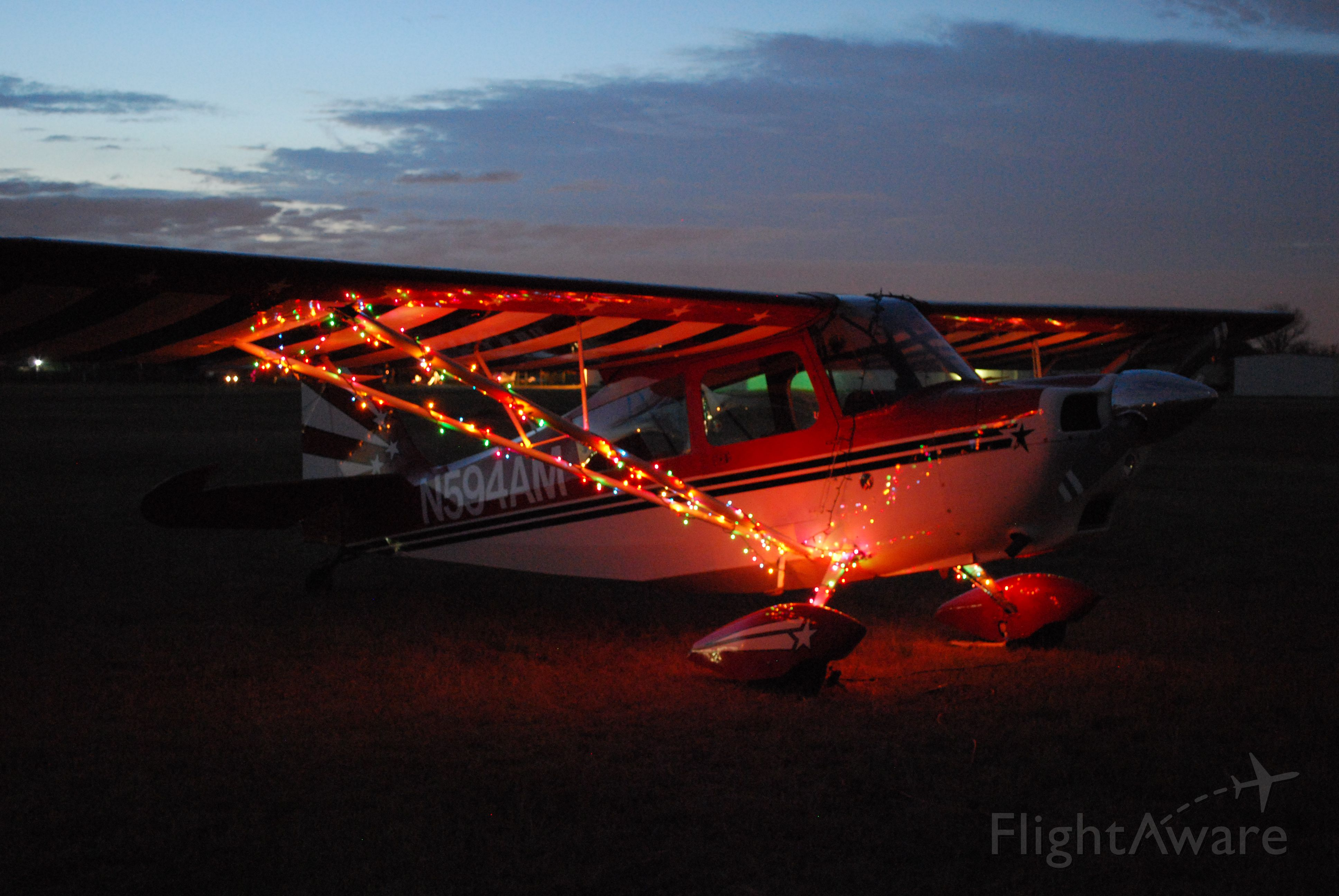 CHAMPION Decathlon (N594AM) - There is something magical about the glow of Christmas lights- add to it the magic and fun of a Decathlon, and visions of thrills will be dancing in pilots