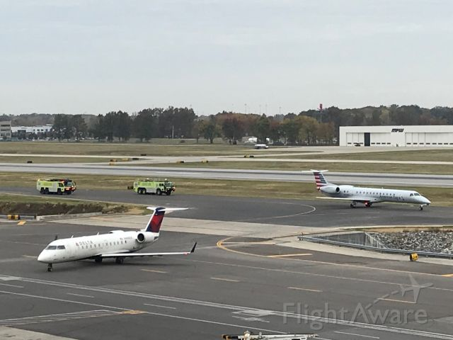 UNKNOWN — - Watching from parking garage as emergency vehicles meet American Airlines flight at Port Columbus John Glenn International Airport, Columbus, OH., 10/25/2019 at 10:30am.