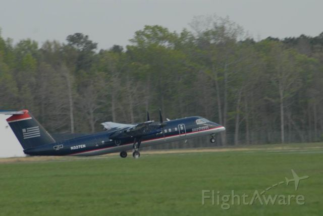 N327EN — - Dash 8 300 Series a/c takingoff towards CLT.