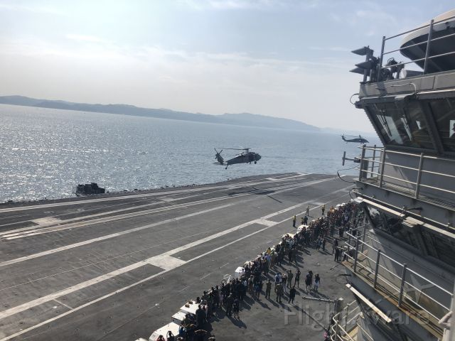 — — - Next to the tower on the USS Ronald Reagan (CVN 76) a special ops team was doing a demo were they fast roped down and got in position for a takedown. SELECT FULL for correct resolution.