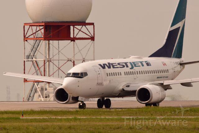 BOEING 737-600 (C-GWCT) - Westjets Boeing 737-600 arriving in Regina on a warm sunny day.