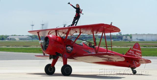 N65263 — - McGUIRE AIR FORCE BASE, WRIGHTSTOWN, NEW JERSEY, USA-MAY 11, 2014: The Third Strike Wing Walking team lands and waves to the crowd after performing at the 2014 Open House and Air Show.