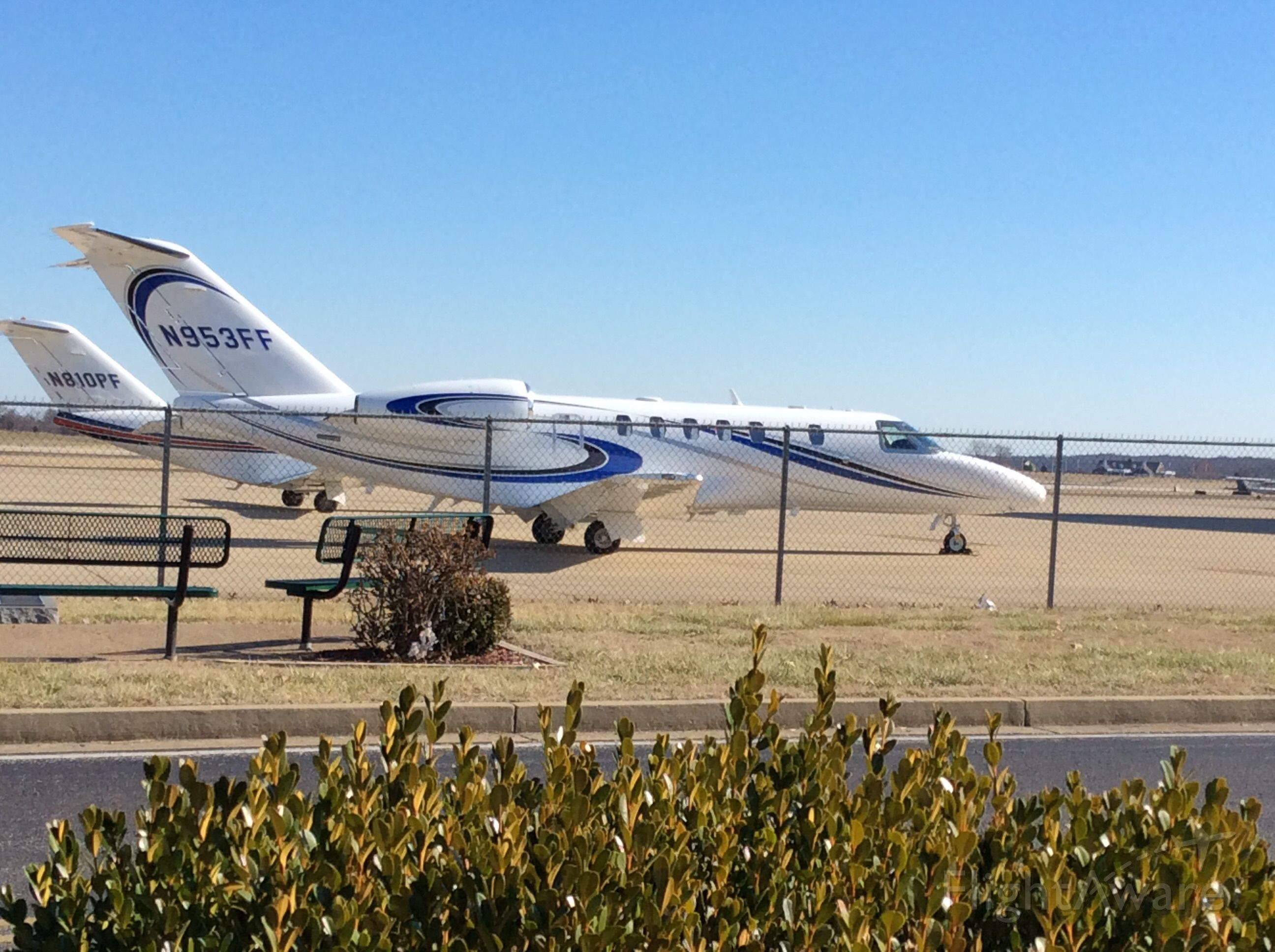 Cessna Citation CJ4 (N953FF) - Nice and clean sitting by the fence at KBWG
