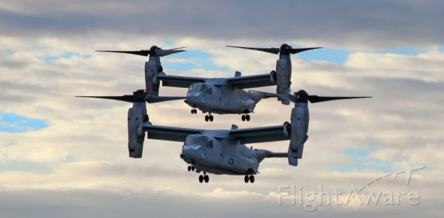 """Bell V-22 Osprey (16-8350) - A pair of United States Marine Corps """"Evil Eyes"""" MV-22B Ospreys (#13 - 168350 in the lead with #06 - 168018 directly behind), call sign """"Keanu"""", are captured here in the last half hour of dusk light as they make their final approach along Reno Tahoe Internationals 16L to touch down at Atlantic Aviation. Both Ospreys are assigned to VMM 163 (Marine Medium Tiltrotor Squadron, 3rd Marine Aircraft Wing) """"Evil Eyes"""" (formerly """"Genie Eyes"""" - see below) at MCAS Miramar.br /This is the first photo of 168350 to be entered into FAs Photo Gallery.br /** The """"Genie Eyes"""" name was inspired by the """"I Dream of Jeannie"""" television sitcom; however, the """"Evil Eyes"""" name was adopted when US ground forces in Vietnam began using that name to refer to VMM 163 aircraft supporting them. In 1966, all Marine units were directed to stop using white paint on their aircraft. VMM 163 commanders used an extremely technical detail to ignore the order and the """"Evil Eyes"""" continued to be painted with black - and WHITE - paint. Later in that same year, as those same commanders were attending a meeting, they began catching hell for ignoring the directive - until a high ranking ground force officer commented on how great a morale boost it had been to see the """"Evil Eyes"""" appear to support the ground forces during a recently-fought battle. The """"Evil Eyes"""" have been black and white ever since.br /br /To read the entire history of VMM 163, click on the link below ....br /br /a rel=nofollow href=http://www.3rdmaw.marines.mil/Units/MAG-16/VMM-163/History/https://www.3rdmaw.marines.mil/Units/MAG-16/VMM-163/History//a"""