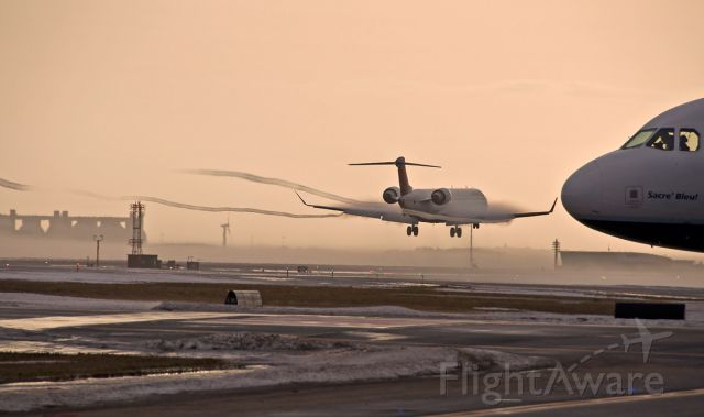 Canadair Regional Jet CRJ-900 — - Vortices -15R landing