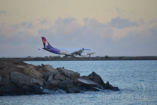 Airbus A330-300 — - Hawaiian A330-200 taxing out to reef runway at PHNL.