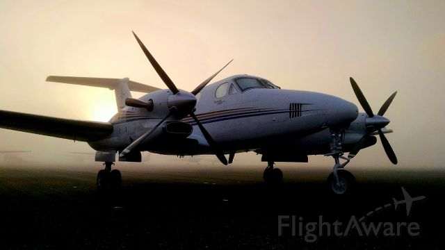 Beechcraft Super King Air 300 (N300MC) - After sunrise on a fog shrouded ramp in Sanford, Florida.