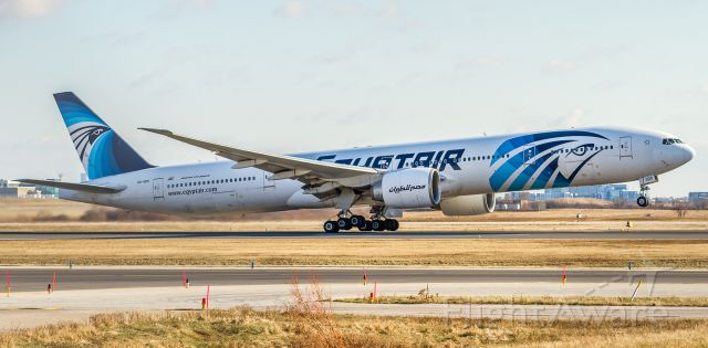 BOEING 777-300ER (SU-GDO) - Slightly one-sided rotation and climb off runway 23 for the trip back to Cairo
