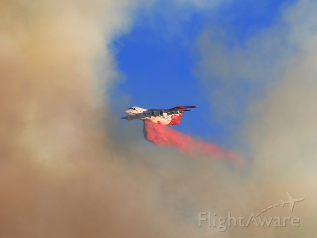 British Aerospace BAe-146-200 (N473NA) - Neptune Aviation Services BAe 146-200 Tanker 01...Late afternoon retardant drop on the  threatening June Fire, June Lake CA. 9-16-14